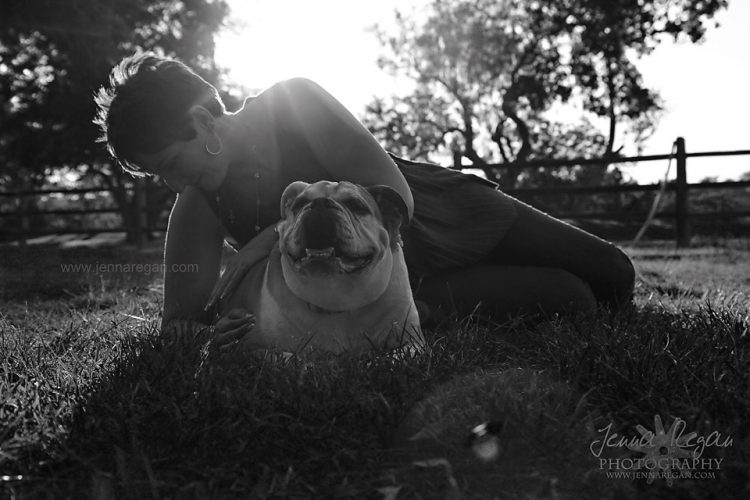 black and white photo of woman with bulldog at sunset fort worth texas