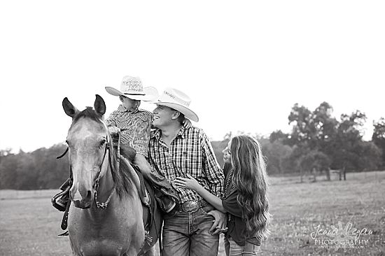 black and white family photo with horse