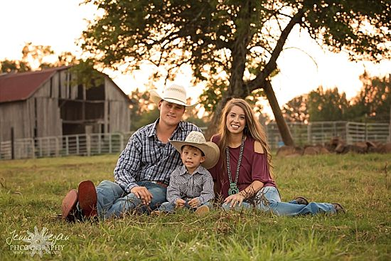 family engagement photos by barn