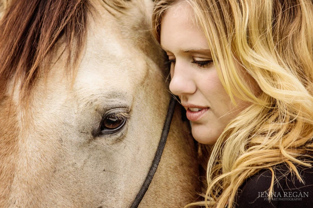 close up of woman and her buckskin horse tender moment during photo session