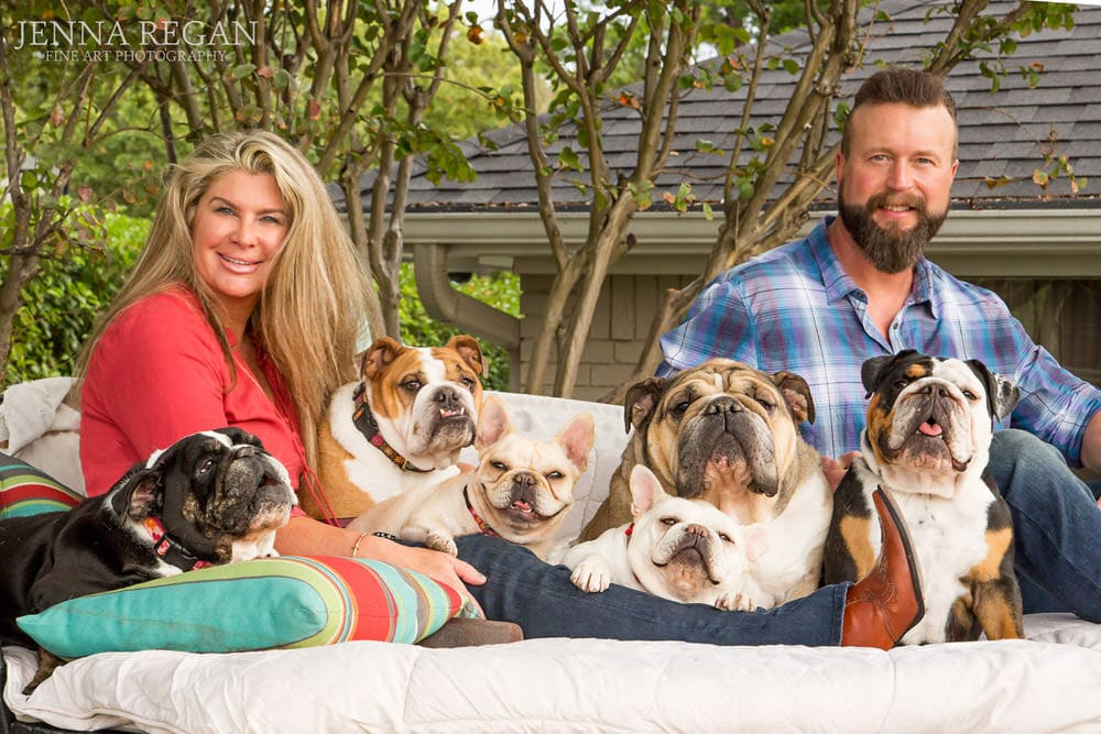 couple with their dogs poses for family photo in rockwall texas