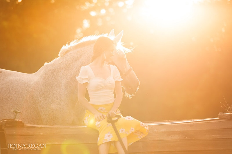 dreamy sun coming through the trees on horse and woman- north texas equine photography