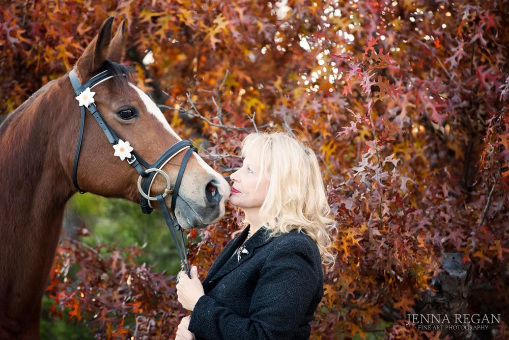 fall leaves woman kissing her english riding horse mckinney texas