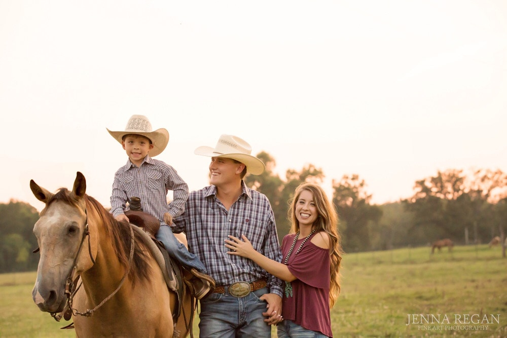 family photo taken on ranch with horses