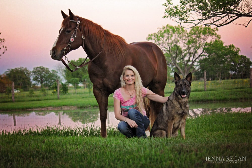 family photo with horse and dog and woman