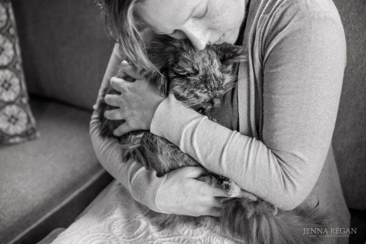fine art photograph of cat and owner in black and white