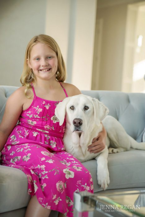 girl in pink dress with her old white lab dog indoor photo shoot texas