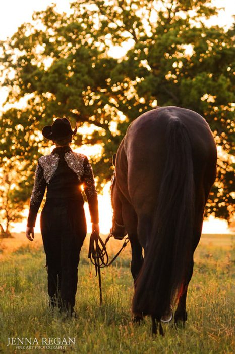 high school senior girl walking off into the sunset with her horse- north texas equine photography