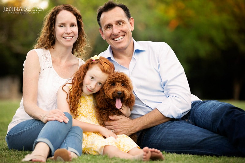 mom, dad, daughter and dog-family photographed with their dog- dallas pet photo shoot- outdoors pet photography