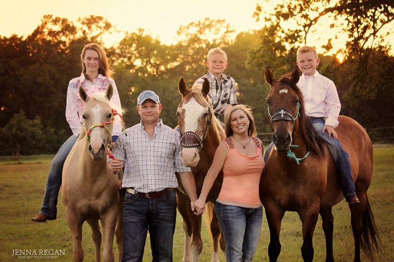 mom dad three kids on riding on 3 horses- north texas equine photo shoot- jenna regan photography