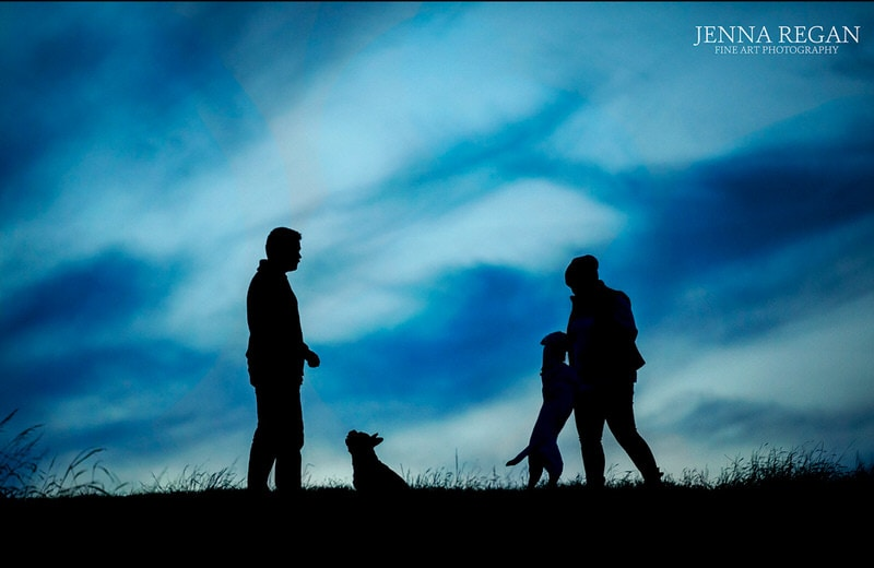 pet and family outside at park at sunset- black and blue silhouette- jenna regan photography