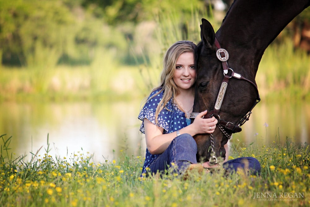 senior girl poses with her american quarter horse during wildflower photo shoot in college station