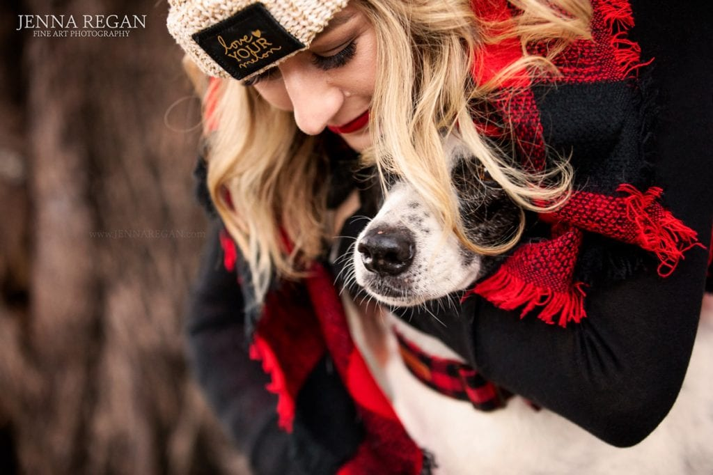 artsy photo of woman hugging her dog dallas pet photo shoot