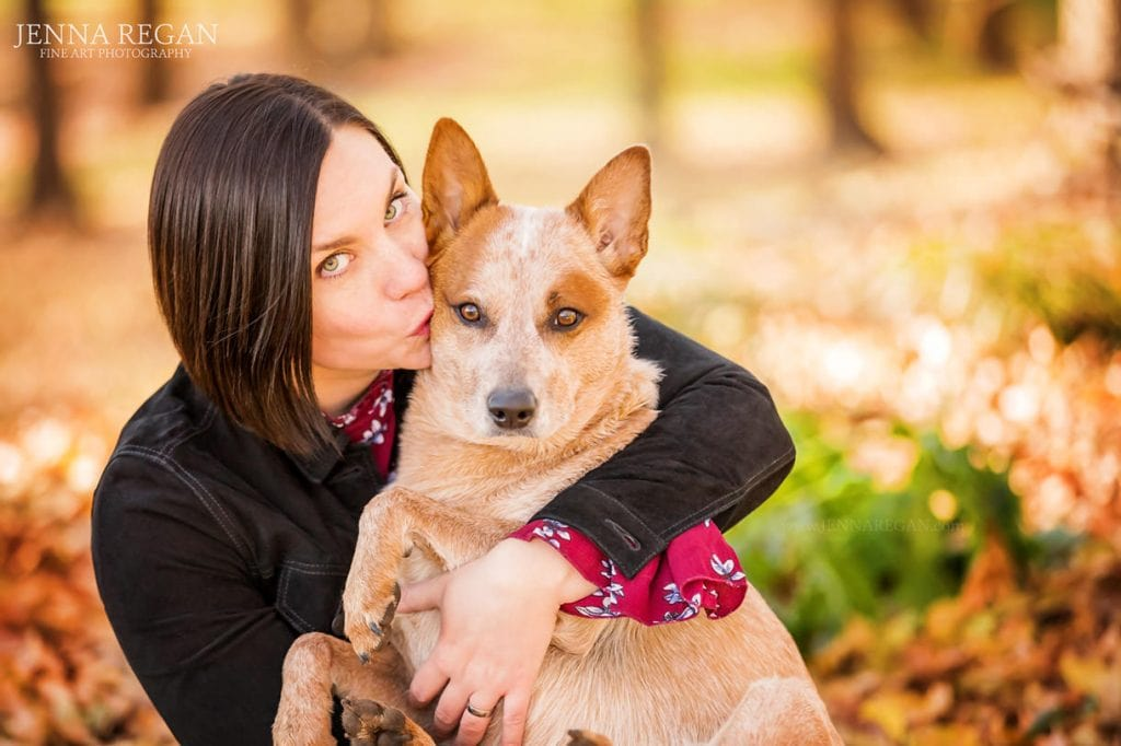 woman kissing dog during family dog photos- jenna regan pet photography